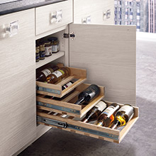 Base cabinet with can and wine bottle pullouts in Arctic specialty laminate