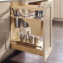 Base utensil pantry pullout cabinet with knife block in Maple Lambswool finish