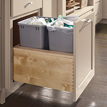 Push to open wastebasket cabinet in Maple Lambswool finish