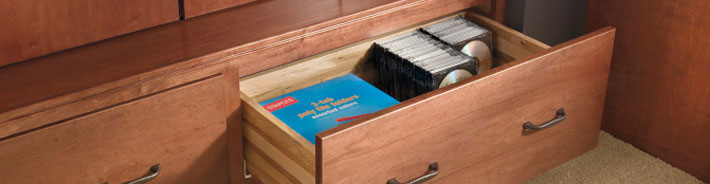 Office supplies in wooden cabinet drawer