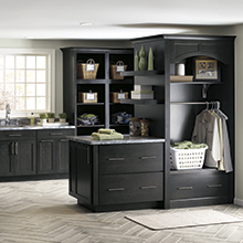Leeton dark gray laundry room cabinets in Cherry Storm