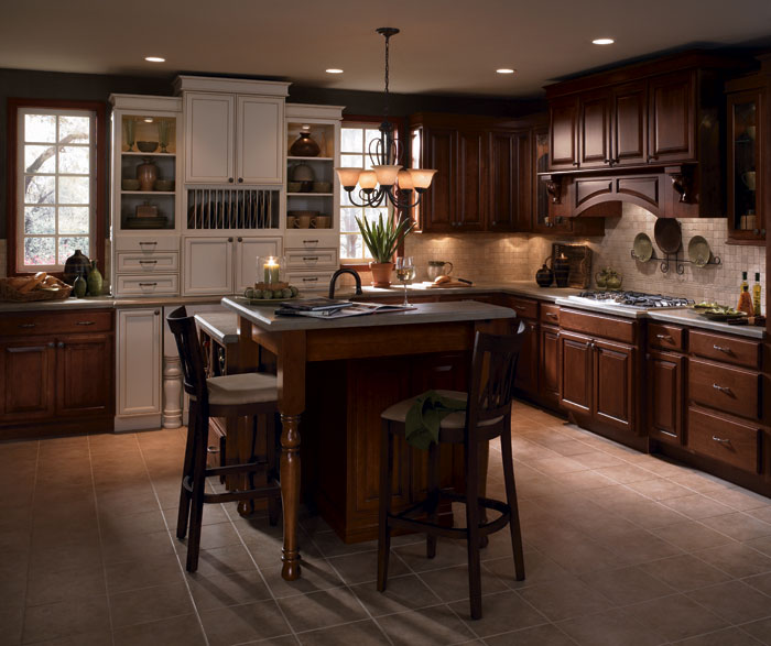 Cherry wood kitchen cabinets with laminate accents by Diamond Cabinetry