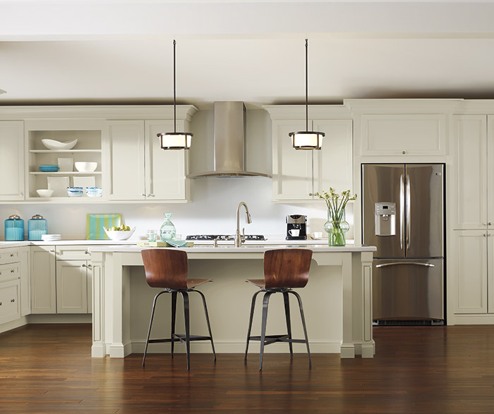 Kitchen Featuring Off White Leeton Cabinets And Hardwood Floors
