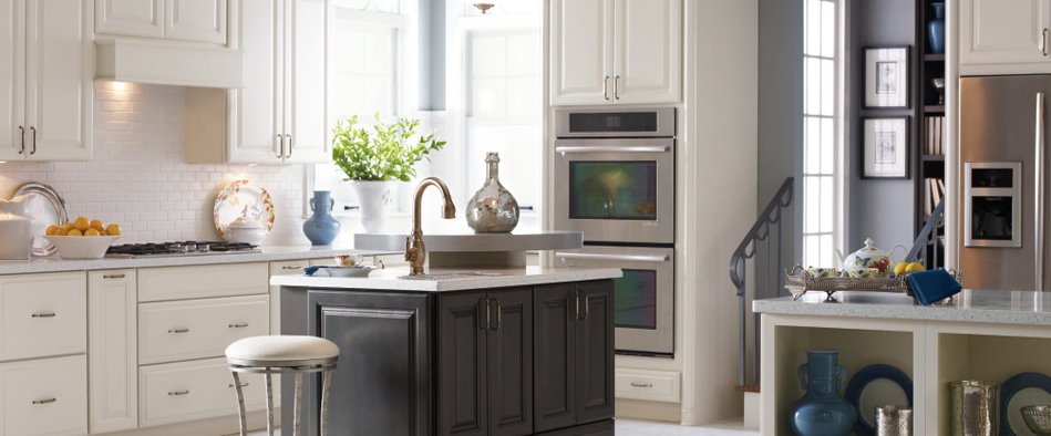 White Kitchen Featuring An Island With Dark Gray Sullivan Cabinets