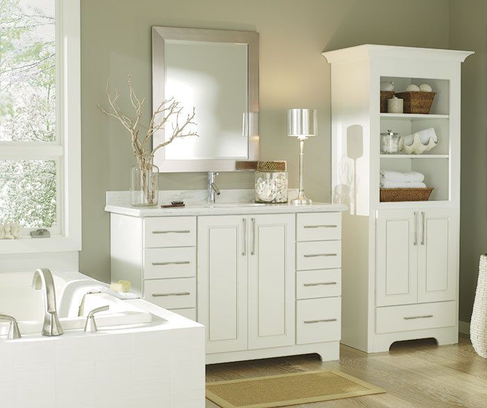 Casual white bathroom cabinets by Diamond Cabinetry