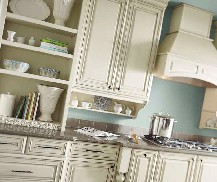 Traditional kitchen featuring cream-colored Selena cabinets with glaze