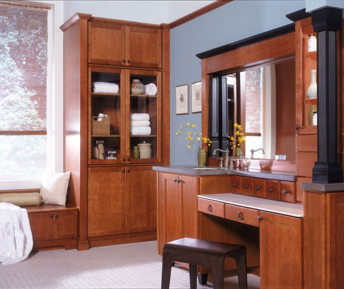 Maple bathroom cabinets in medium finish by Diamond Cabinetry