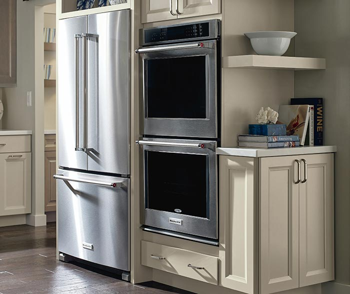 Angle of Wells Maple kitchen showing double oven cabinet