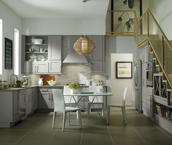 Grey cabinets in casual kitchen by Diamond Cabientry