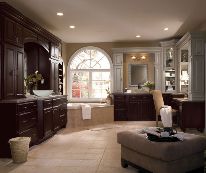 Dark wood cabinets in traditional bathroom by Diamond Cabinetry